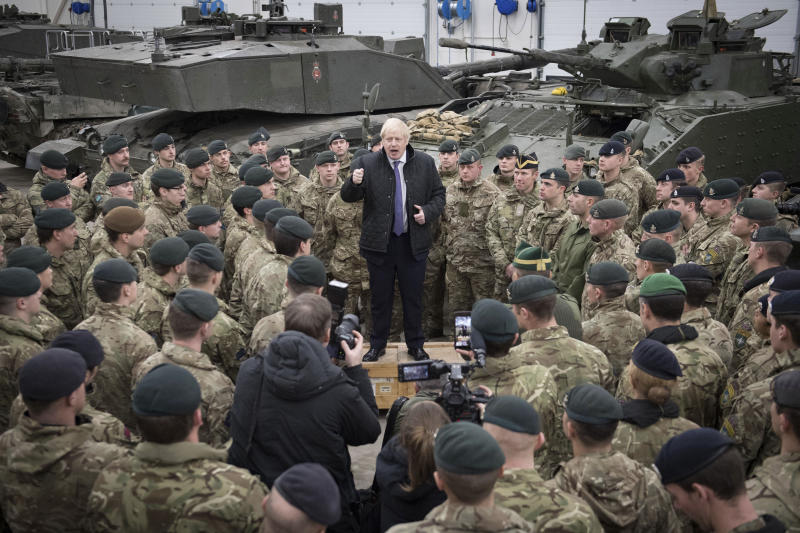 Britain's Prime Minister Boris Johnson addresses British soldiers after serving Christmas lunch to British troops stationed in Estonia during a one-day visit to the Baltic country, in Tallinn, Saturday, Dec. 21, 2019. (Stefan Rousseau/Pool photo via AP)