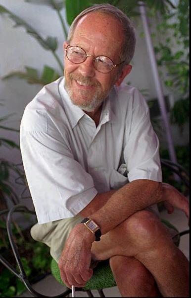 "FILE - In this June, 18, 1996 file photo, writer Elmore Leonard sits on the set of his latest book-turned movie, ""Pronto,"" in Miami Beach, Fla. Leonard, a former adman who later in life became one of America's foremost crime writers, has died. He was 87. His researcher says he passed away Tuesday morning, Aug. 20, 2013 from complications from a stroke. (AP Photo/Marta Lavandier)"