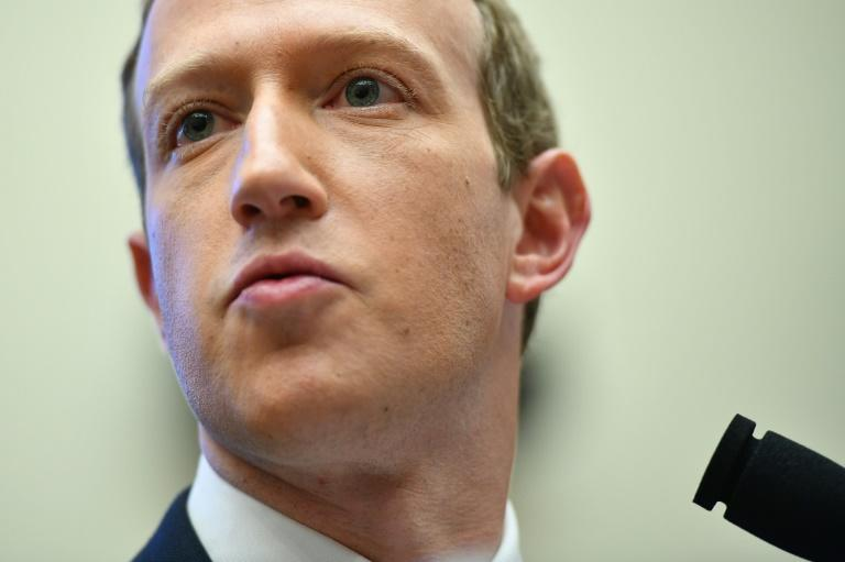 Facebook chairman Mark Zuckerberg, pictured October 2019, has said the Libra cryptocurrency will not be launched until it receives all needed approvals (AFP Photo/MANDEL NGAN)
