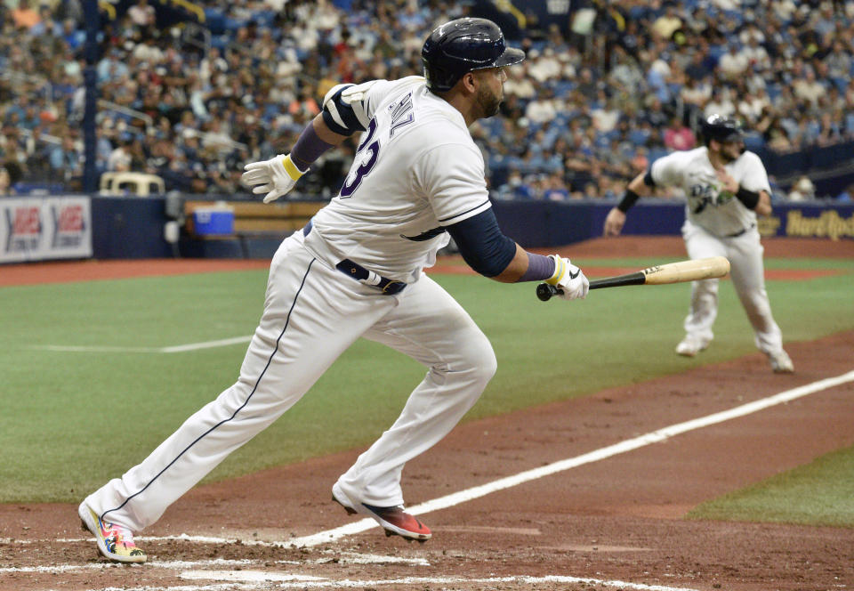 Tampa Bay Rays' Mike Zunino, background, races home to score on an infield ground ball hit by Nelson Cruz, foreground, off Chicago White Sox starter Dallas Keuchel during the second inning of a baseball game, Saturday, Aug. 21, 2021, in St. Petersburg, Fla. (AP Photo/Steve Nesius)