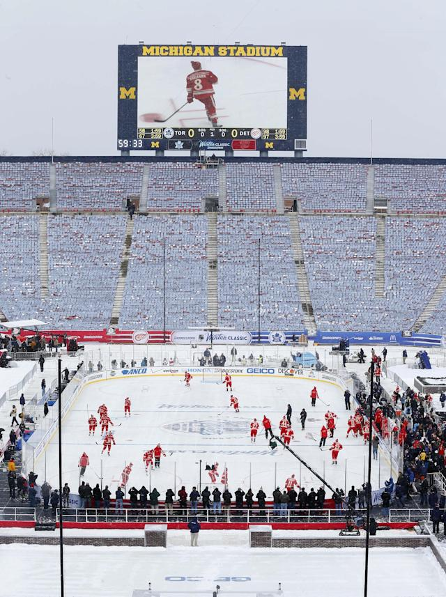 The Detroit Red wings practice on the outdoor rink for the NHL Winter Classic hockey game against the Toronto Maple Leafs at Michigan Stadium in Ann Arbor, Mich., Tuesday, Dec. 31, 2013. The game is scheduled for New Year's Day. (AP Photo/Paul Sancya)