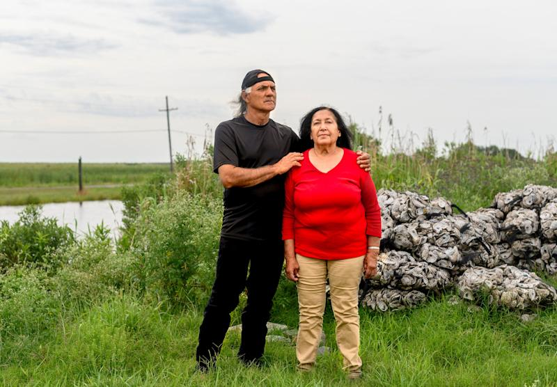 Theresa and Donald Dardar pose for a portrait in the Pointe-au-Chien community in Lafourche Parish, Louisiana., on May 19, 2019. (Photo: Emily Kask for HuffPost)