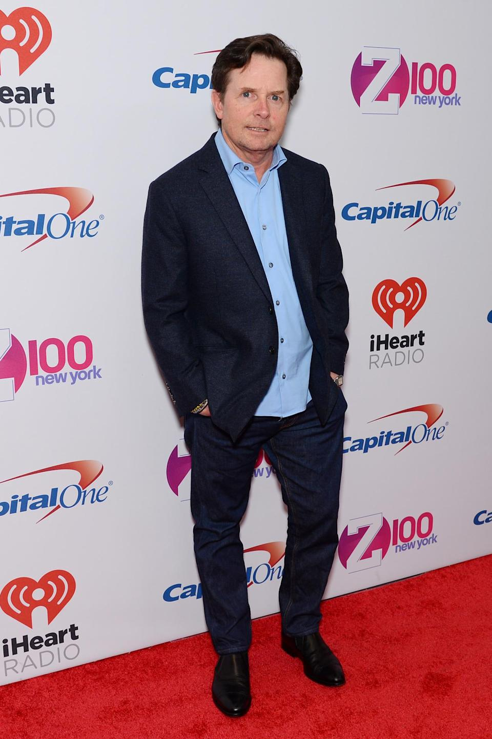 <p>Michael J. Fox came out to enjoy the show in traditional dad attire.</p>