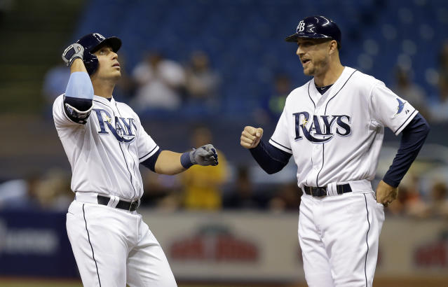 FILE - In this April 8, 2015, file photo, Tampa Bay Rays' Asdrubal Cabrera, left, celebrates with first base coach Rocco Baldelli after singling off Baltimore Orioles starting pitcher Miguel Gonzalez during the first inning of a baseball game, in St. Petersburg, Fla. Two people with knowledge of the decision tell The Associated Press that the Minnesota Twins have hired Tampa Bay Rays assistant coach Rocco Baldelli as their new manager. The 37-year-old Baldelli replaces Paul Molitor, who was fired after four seasons with a 305-343 record. The sources spoke to The AP on Thursday, Oct. 25, 2018, on condition of anonymity, because the Twins had not yet made the announcement about Baldelli, who spent the last four years on the staff of Rays manager Kevin Cash. (AP Photo/Chris O'Meara, File)