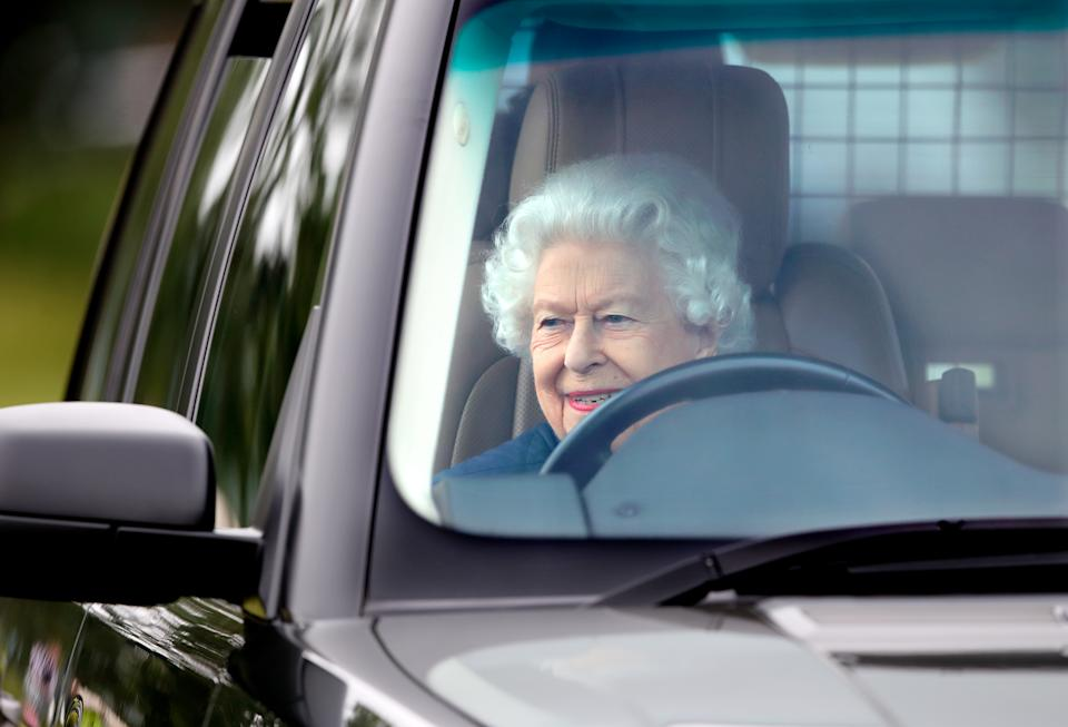 WINDSOR, UNITED KINGDOM - JULY 02: (EMBARGOED FOR PUBLICATION IN UK NEWSPAPERS UNTIL 24 HOURS AFTER CREATE DATE AND TIME) Queen Elizabeth II seen driving her Range Rover car as she attends day 2 of the Royal Windsor Horse Show in Home Park, Windsor Castle on July 2, 2021 in Windsor, England. (Photo by Max Mumby/Indigo/Getty Images)