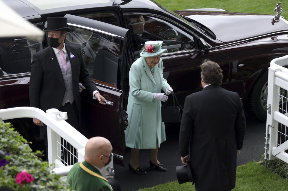 Britain's Queen Elizabeth II, smiles as she arrives, during day five of of the Royal Ascot horserace meeting, at Ascot Racecourse, in Ascot, England, Saturday June 19, 2021. (Steven Paston/PA via AP)