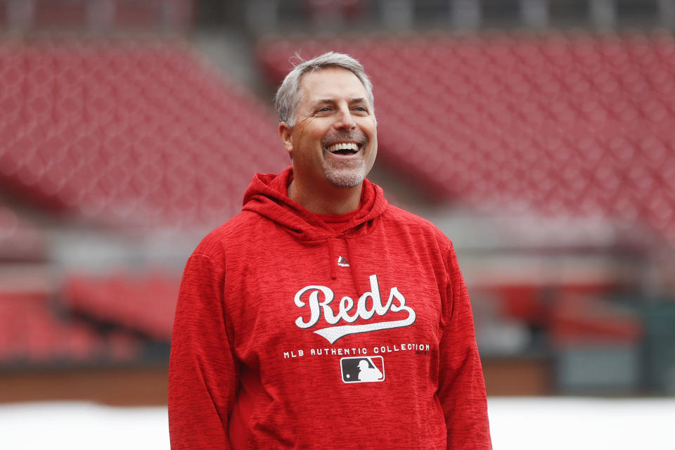 Cincinnati Reds manager Bryan Price smiles during workouts at Great American Ballpark, Thursday, March 29, 2018, in Cincinnati. Their first game of the regular season against the Washington Nationals was postponed until Friday due to weather. (AP Photo/John Minchillo)