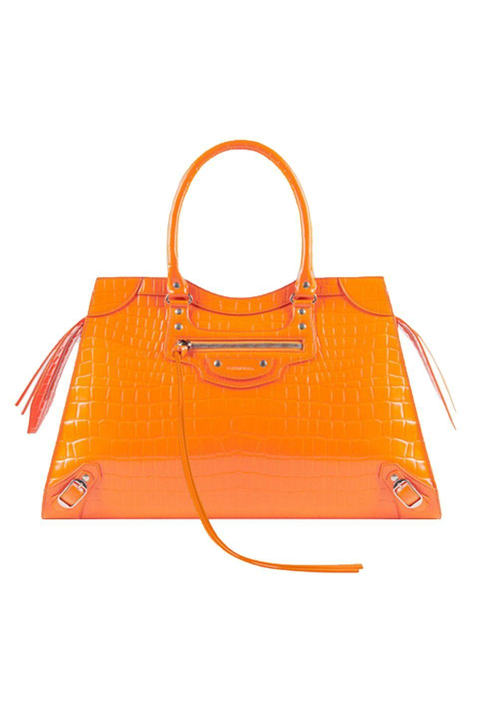 "<p>Balenciaga's Classic city bag turns twenty this year, a testament to its enduring style. To celebrate, Balenciaga traded in its tabloid-friendly slouchy shape once loved by Kate Moss for a more structured body. True to Demna Gvasalia's futuristic eye, the New Classic is being released in a croc-embossed neon orange that feels more 2020 than 2000. </p><p><em>Balenciaga, $2,490; balenciaga.com</em></p><p><a class=""link rapid-noclick-resp"" href=""https://go.redirectingat.com?id=74968X1596630&url=https%3A%2F%2Fwww.balenciaga.com%2Fus%2Fneo-classic-handbags_cod22009233gp.html%23%2Fus%2Fwomen%2Fneo-classic-women&sref=https%3A%2F%2Fwww.elle.com%2Ffashion%2Fshopping%2Fg33416567%2Fdesigner-it-bags-pre-fall-2021%2F"" rel=""nofollow noopener"" target=""_blank"" data-ylk=""slk:SHOP NOW"">SHOP NOW</a></p>"