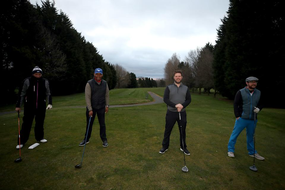 Golfers socially distance ahead of teeing off at the first tee at Telford Golf Club, Telford, Shropshire, following the easing of England's lockdown to allow far greater freedom outdoors. Picture date: Monday March 29, 2021.