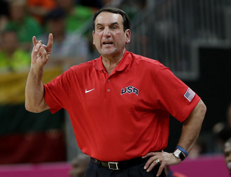 FILE- In this Aug. 4, 2012, file photo, United States coach Mike Krzyzewski signals to players during a preliminary men's basketball game against Lithuania at the 2012 Summer Olympics in London. A person with knowledge of the decision says Krzyzewski has agreed to return as U.S. men's Olympic basketball coach. He was originally expected to step down but instead will attempt to lead the Americans to a third straight gold medal, the person tells The Associated Press on condition of anonymity because no official announcement has been made.  (AP Photo/Eric Gay)