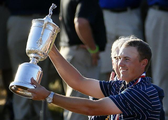 Jordan Spieth holds up the trophy after winning the U.S. Open. (AP)