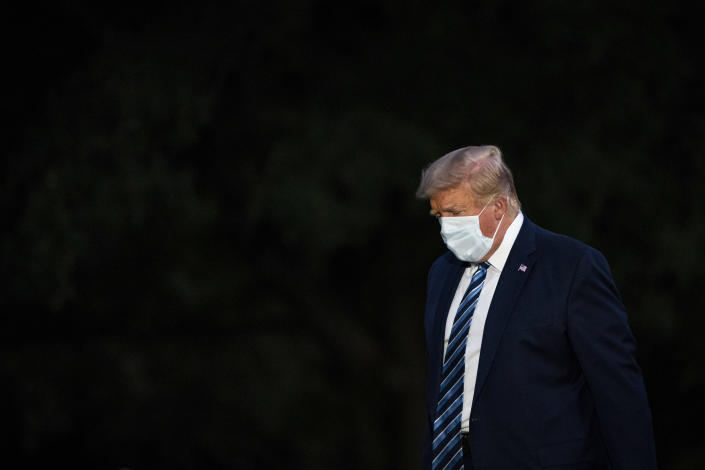 WASHINGTON, DC - OCTOBER 5: President Donald J. Trump disembarks Marine One and walks across the South Lawn as he returns home after receiving treatments for the covid-19 coronavirus at Walter Reed National Military Medical Center, at the White House on Monday, Oct 05, 2020 in Washington, DC. (Photo by Jabin Botsford/The Washington Post via Getty Images)