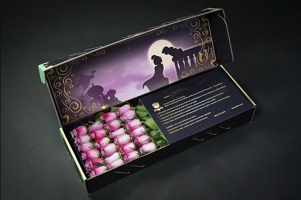 <p>Show your partner that they've shown you a whole new world with this <span><strong>Aladdin</strong> design</span> ($109-$199), which features a dreamy magic carpet scene from the Disney flick and either one or two dozen lavender or red roses.</p>