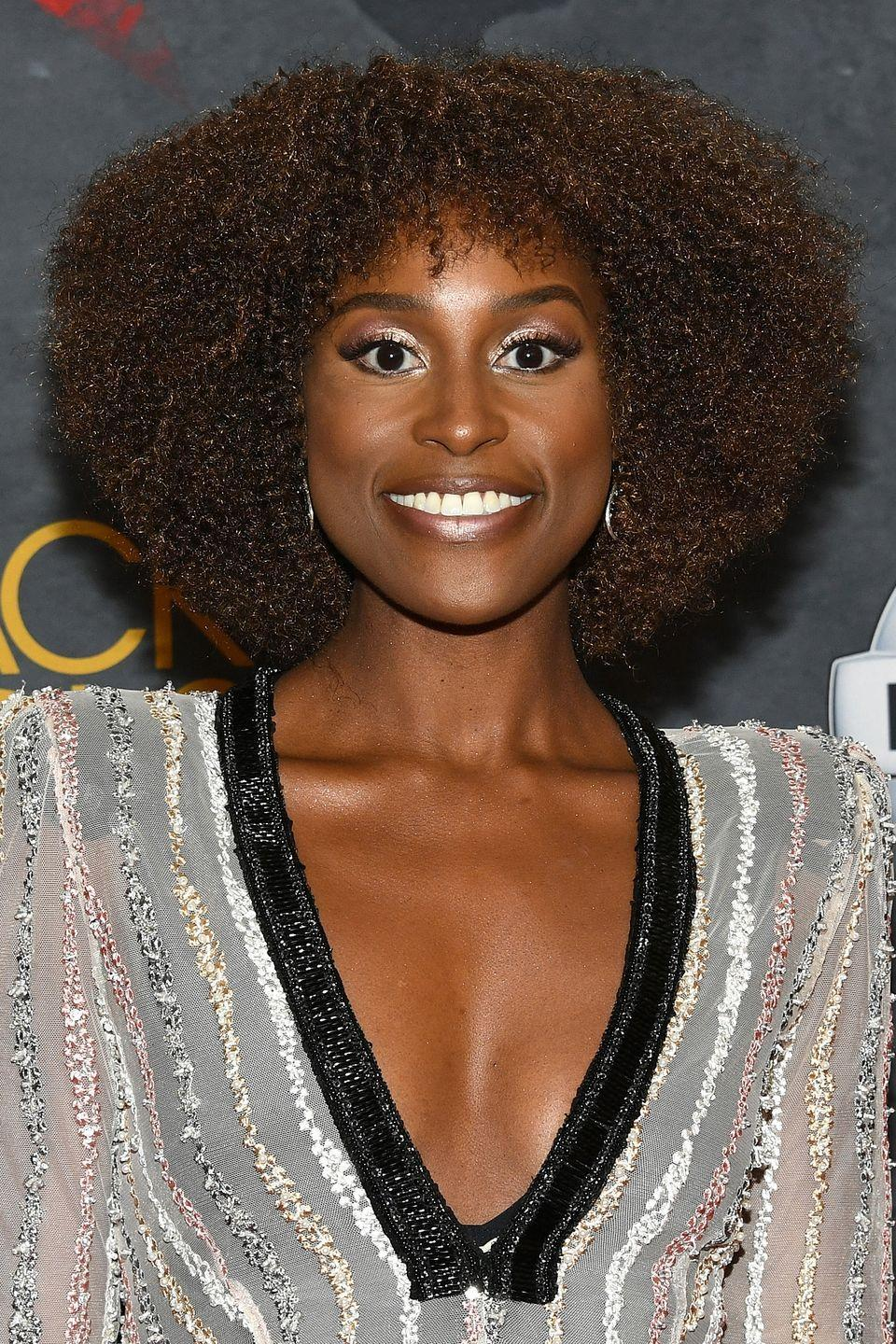 """<p><strong>Issa Rae</strong>'s tight curls create a full, fabulous frame for her face. <a href=""""https://www.goodhousekeeping.com/beauty/hair/g33267765/types-of-bangs/"""" rel=""""nofollow noopener"""" target=""""_blank"""" data-ylk=""""slk:Bangs"""" class=""""link rapid-noclick-resp"""">Bangs</a> of the same texture are the perfect finishing touch.</p>"""