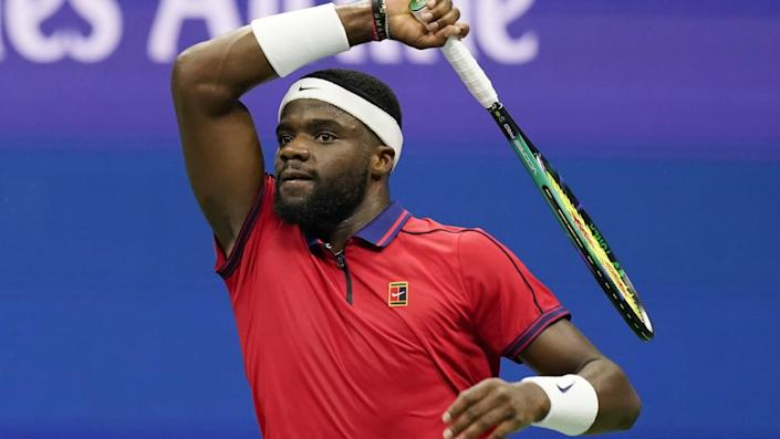 Frances Tiafoe returns a shot in her victory over Andrey Rublev at the US Open on Saturday.
