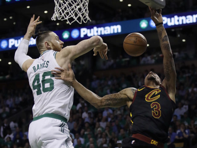 Boston Celtics center Aron Baynes (46) blocks a shot by Cleveland Cavaliers guard George Hill (3) during the first quarter of Game 5 of the NBA basketball Eastern Conference finals Wednesday, May 23, 2018, in Boston. (AP Photo/Charles Krupa)