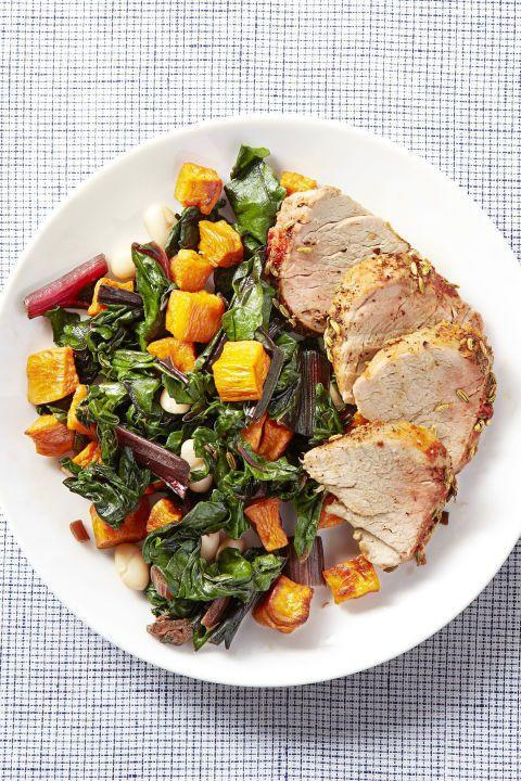 """<p>Tomatoes and fennel seeds flavor this pork dish, while sweet potatoes and white beans add color and crunch to Swiss chard.</p><p><strong><a href=""""https://www.countryliving.com/food-drinks/recipes/a23645/roast-pork-winter-veggies-recipe-ghk0315/"""" rel=""""nofollow noopener"""" target=""""_blank"""" data-ylk=""""slk:Get the recipe"""" class=""""link rapid-noclick-resp"""">Get the recipe</a>.</strong> </p>"""