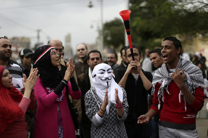 FILE - In this Wednesday, Dec. 5, 2012 file photo, Egyptian protesters chant anti Muslim Brotherhood slogans outside the presidential palace, in Cairo, Egypt. The accusations against two Muslim Brotherhood officials that have been ordered to stand trial for allegedly kidnapping and torturing three men at the group's headquarters there, according to the city prosecutor's office, stem from November protests that swept much of the country, including Damanhour in the Nile Delta. The protests followed President Mohammed Morsi's decrees, which have since been rescinded, giving himself near absolute powers. (AP Photo/Hassan Ammar, File)