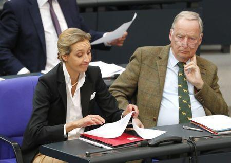 Leaders of the anti-immigration party Alternative for Germany (AfD) Bundestag group Alice Weidel and Alexander Gauland attend the first plenary session of German lower house of Parliament after a general election in Berlin, Germany, October 24, 2017. REUTERS/Fabrizio Bensch