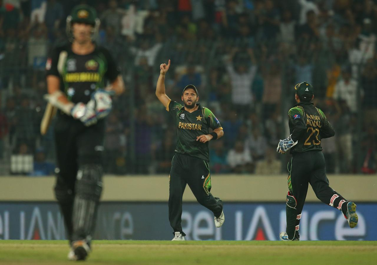 DHAKA, BANGLADESH - MARCH 23:  Shahid Afridi of Pakistan celebrates after running out Mitchell Starc (L) of Australia during the ICC World Twenty20 Bangladesh 2014 match between Australia and Pakistan at Sher-e-Bangla Mirpur Stadium on March 23, 2014 in Dhaka, Bangladesh.  (Photo by Scott Barbour/Getty Images)