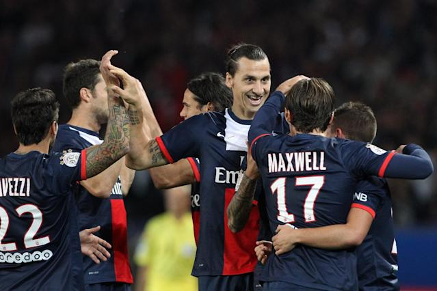 Paris Saint Germain's forward Zlatan Ibrahimovic from Sweden, center, celebrates with teammates, after he scores a goal, during his French League One soccer match against Monaco, at the Parc des Princes stadium, in Paris, Sunday, Sept. 22, 2013. (AP Photo/Thibault Camus)
