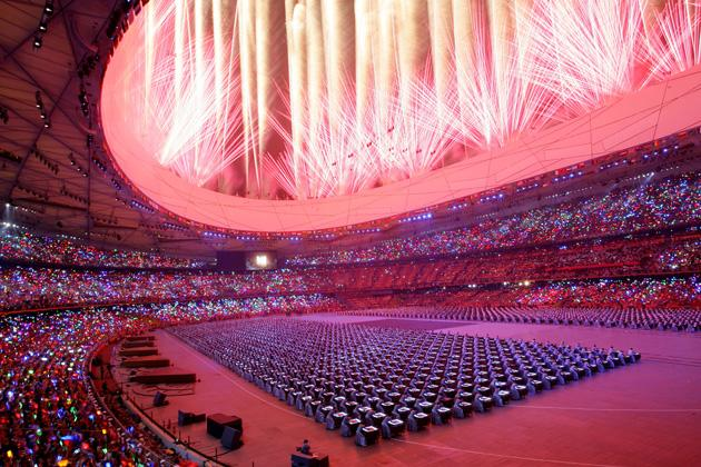 BEIJING - AUGUST 08:  Fireworks go off during the Opening Ceremony for the 2008 Beijing Summer Olympics at the National Stadium on August 8, 2008 in Beijing, China.  (Photo by Vladimir Rys/Bongarts/Getty Images)