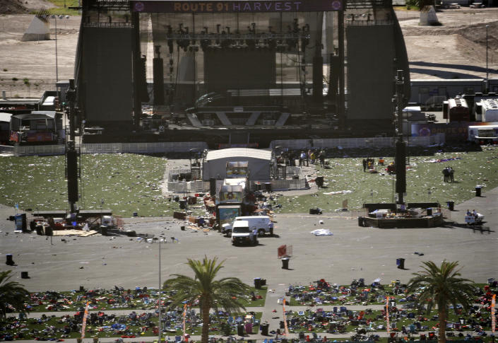 <p>Debris is strewn through the scene of a mass shooting at a music festival near the Mandalay Bay resort and casino on the Las Vegas Strip, Monday, Oct. 2, 2017, in Las Vegas. (Photo: John Locher/AP) </p>