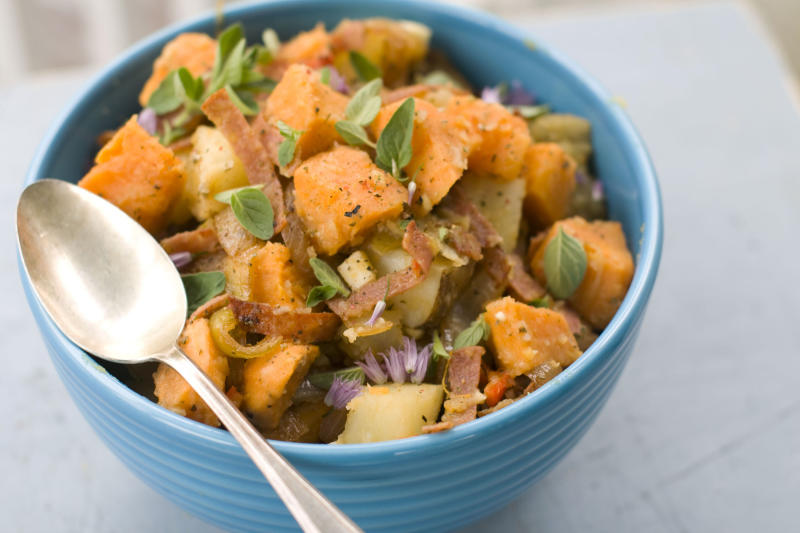 This image taken on May 14, 2012 ahows a recipe for Italian grinder potato salad prepared with sweet potatoes, cherry peppers, and sliced salami in Concord, N.H. (AP Photo/Matthew Mead)