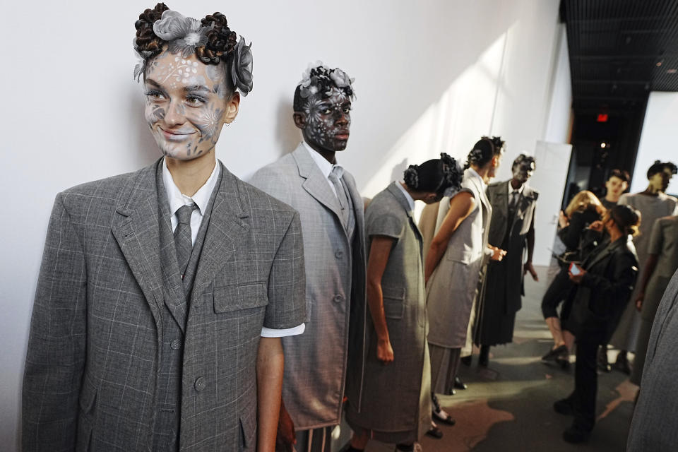 Models appear backstage in preparation for the Thom Browne fashion show during New York Fashion Week at The Shed, on Saturday, Sept. 11, 2021, in New York. (Photo by Charles Sykes/Invision/AP)