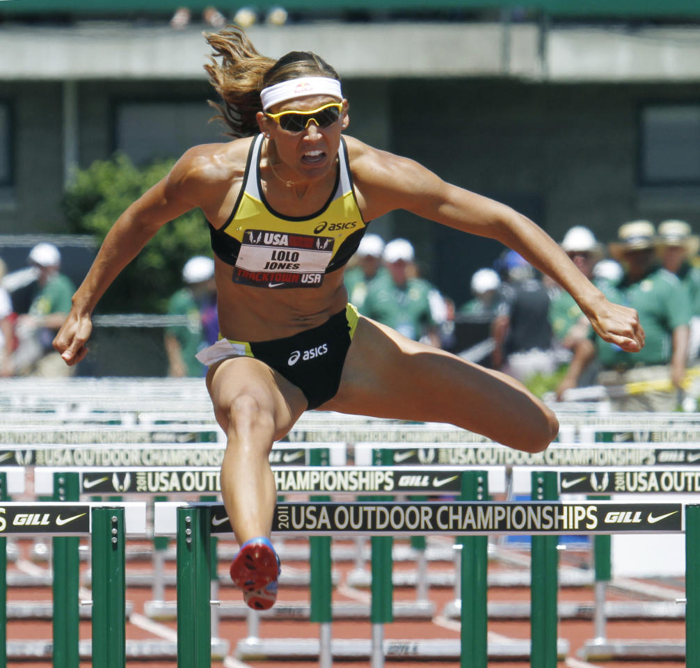 Lolo Jones clears the last hurdle on her way to qualifying in a preliminary heat of the 100 hurdles during the U.S. track and field championships in Eugene, Ore., Saturday, June 25, 2011. Jones will compete in Sunday's final. (AP Photo/Don Ryan)
