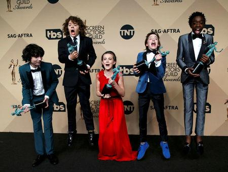 "FILE PHOTO: The cast of ""Stranger Things"" poses with the awards they won for Outstanding Performance by an Ensemble in a Drama Series backstage at the 23rd Screen Actors Guild Awards in Los Angeles, California, U.S., January 29, 2017.  REUTERS/Mario Anzuoni/File Photo"
