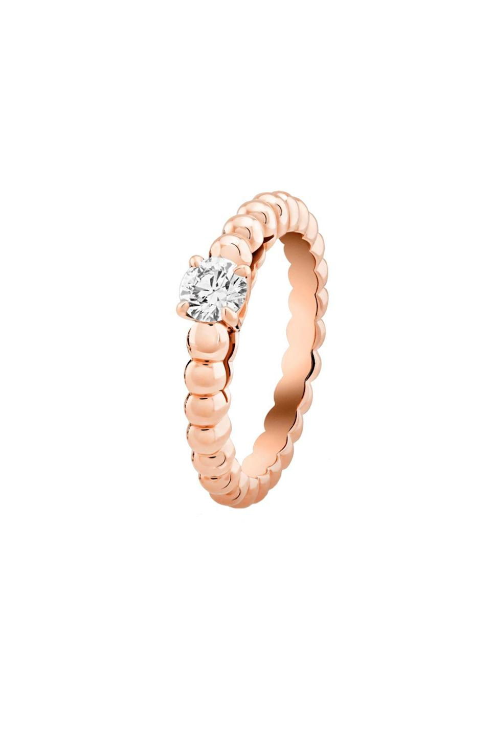 """<p><strong>Van Cleef & Arpels</strong></p><p>vancleefarpels.com</p><p><strong>$3650.00</strong></p><p><a href=""""https://go.redirectingat.com?id=74968X1596630&url=https%3A%2F%2Fwww.vancleefarpels.com%2Fus%2Fen%2Fcollections%2Fengagement%2Fengagement-rings%2Fvcaro1vc00---perlee-solitaire-rose-gold-round-diamond.html&sref=https%3A%2F%2Fwww.townandcountrymag.com%2Fstyle%2Fjewelry-and-watches%2Fg36344130%2Funique-engagement-rings-online%2F"""" rel=""""nofollow noopener"""" target=""""_blank"""" data-ylk=""""slk:Shop Now"""" class=""""link rapid-noclick-resp"""">Shop Now</a></p><p>The beaded rose gold band is handmade in Van Cleef's atelier. Choose from .3 to a 1-carat diamond diamond solitaire to top it, <em>et voilà, </em>the ring of her dreams. </p>"""