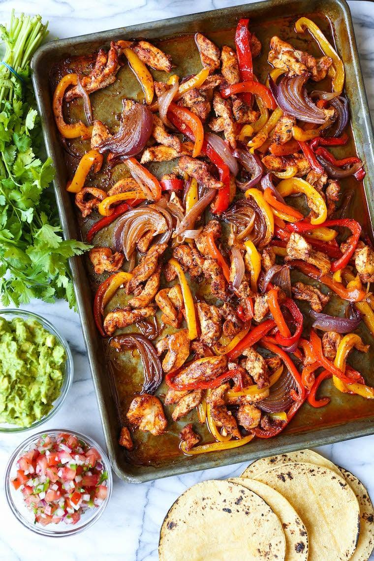 """<p>Fajitas that are easy to make and require minimal cleanup? Sounds like our kind of meal. We recommend prepping the chicken and veggies early in the week and then alternate serving them over rice or in corn tortillas to keep things interesting.</p> <p><strong>Get the recipe:</strong> <a href=""""https://damndelicious.net/2019/07/24/sheet-pan-chicken-fajitas/"""" class=""""link rapid-noclick-resp"""" rel=""""nofollow noopener"""" target=""""_blank"""" data-ylk=""""slk:sheet-pan fajitas"""">sheet-pan fajitas</a></p>"""