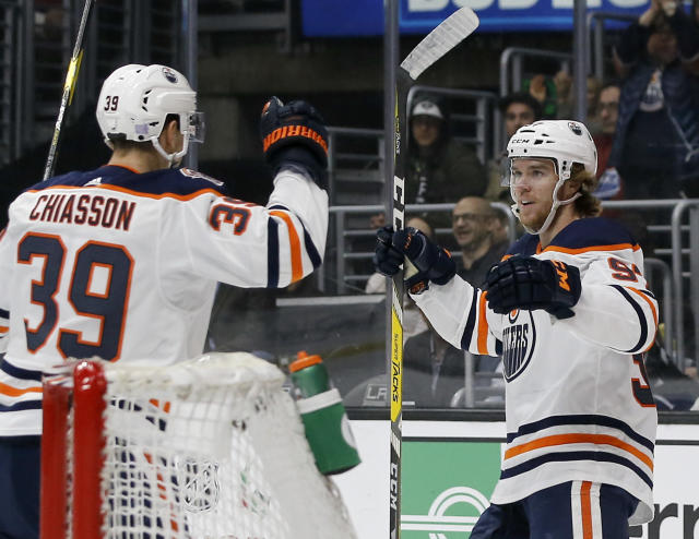 Edmonton Oilers center Connor McDavid, right, celebrates his goal with right wing Alex Chiasson during the first period of the team's NHL hockey game against the Los Angeles Kings in Los Angeles, Sunday, Nov. 25, 2018. (AP Photo/Alex Gallardo)