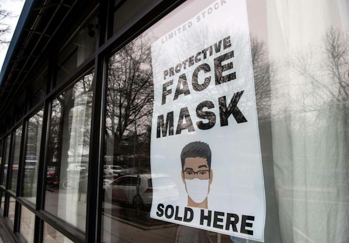 """Vice President Mike Pence said there has been a """"dramatic"""" increase in production of protective face masks amid a shortage that led health authorities to advise the use bandanas or scarves in the event of an emergency (AFP Photo/NICHOLAS KAMM)"""