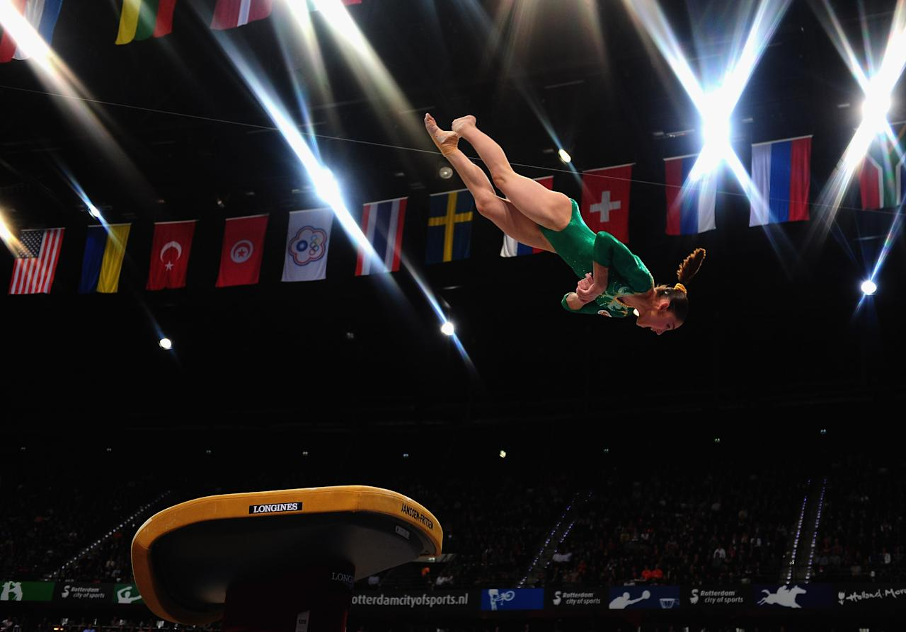 ROTTERDAM, NETHERLANDS - OCTOBER 23:  Aliya Mustafina of Russia competes on the Vault during the Apparatus Final of the 42nd Artistic Gymnastics World Championships at Ahoy on October 23, 2010 in Rotterdam, Netherlands.  (Photo by Jamie McDonald/Getty Images)