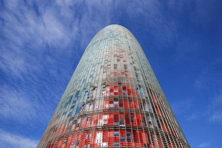 "French climber Alain Robert, also known as ""The French Spiderman"", scales the 38-story skyscraper Torre Agbar in Barcelona"