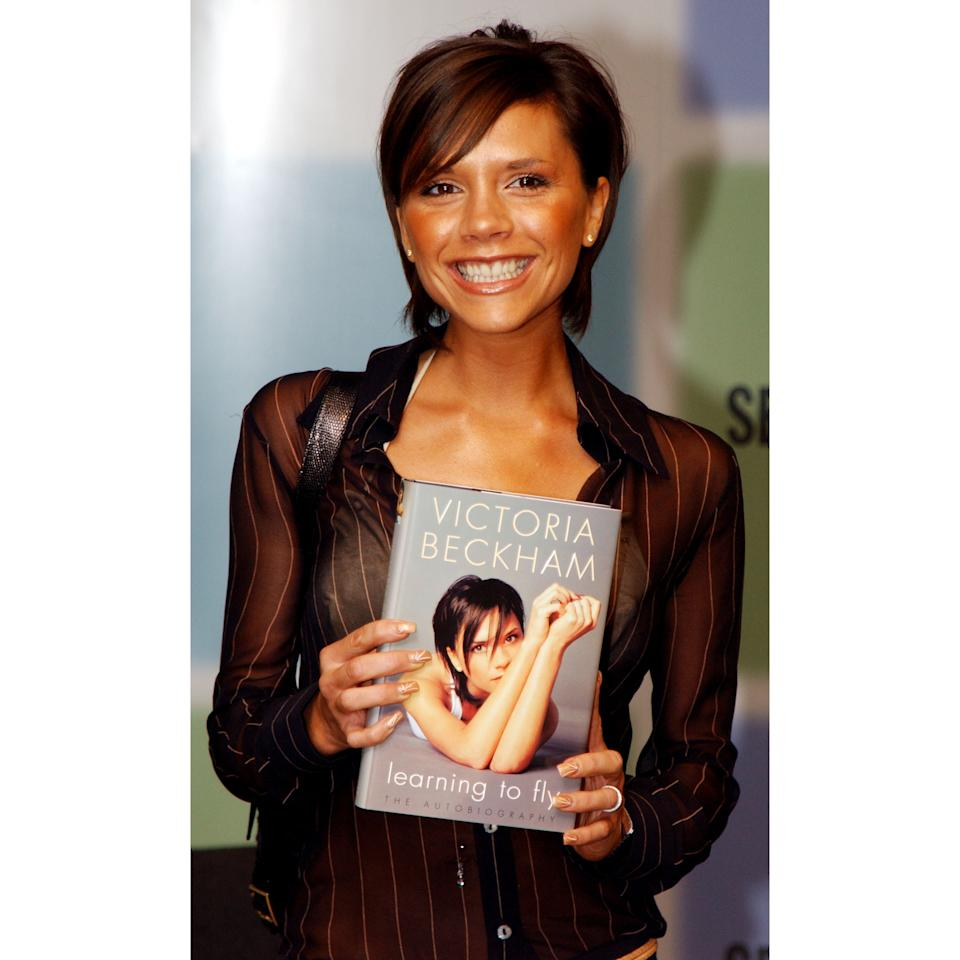 <p>Beckham may not have been smiling on the cover, but she was grinning pretty hard at her 'Learning to Fly' book singing in 2001.</p>