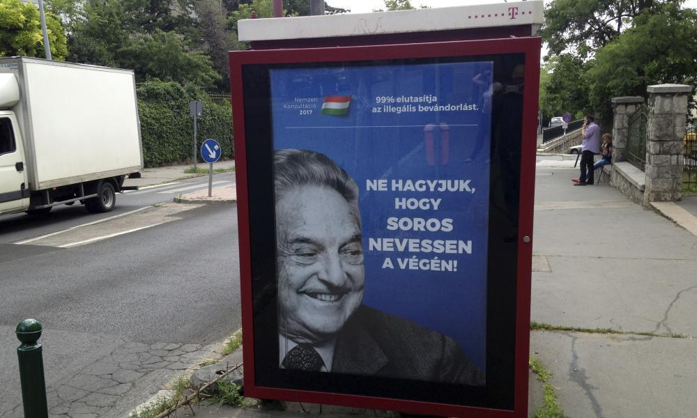 """<span class=""""element-image__caption"""">An anti-Soros campaign ad reading '99% reject illegal migration' and 'Let's not allow Soros to have the last laugh' in Budapest, Hungary.</span> <span class=""""element-image__credit"""">Photograph: Pablo Gorondi/AP</span>"""
