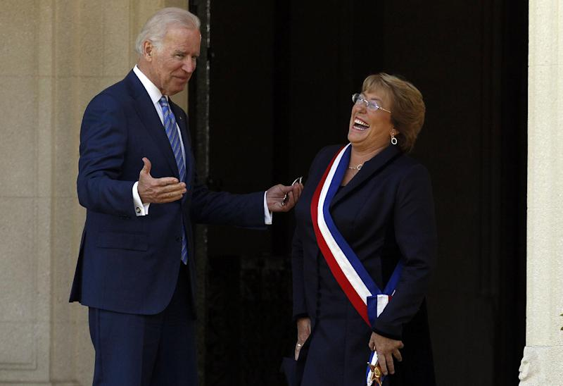 Chile's newly sworn-in President Michelle Bachelet receives Vice President Joe Biden on the front steps of the Cerro Castillo presidential residence, in Vina del Mar, Chile on Tuesday, March 11, 2014. Bachelet, who led Chile from 2006-2010, was sworn-in as president on Tuesday. (AP Photo/Luis Hidalgo).