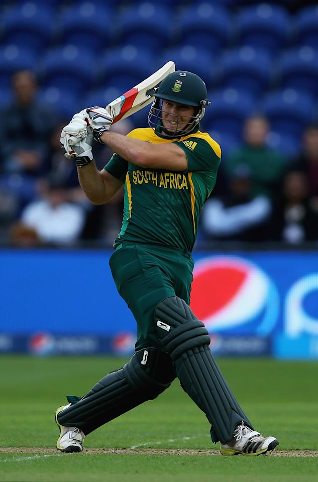 CARDIFF, WALES - JUNE 14:  David Miller of South Africa hits the ball towards the boundary during the ICC Champions Trophy Group B match between West Indies and South Africa at SWALEC Stadium on June 14, 2013 in Cardiff, Wales.  (Photo by Matthew Lewis-ICC/ICC via Getty Images)