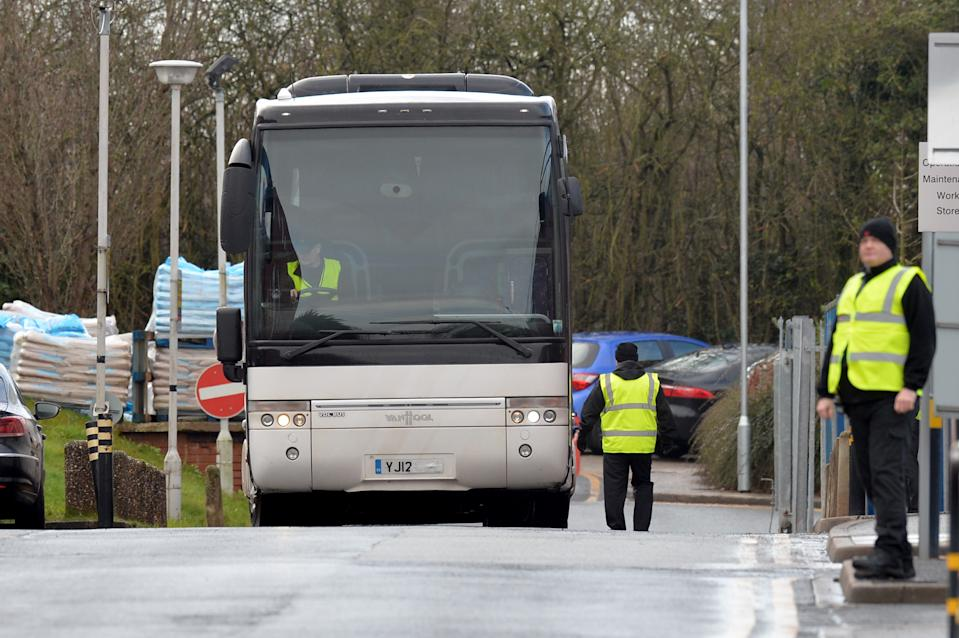 WIRRAL, MERSEYSIDE - FEBRUARY 13: A coach carrying the first British Coronavirus evacuees leaves Arrowe Park Hospital as the patients leave quarantine on February 13, 2020 in Wirral, Merseyside. 83 people are expected to leave quarantine today after their test results for the coronavirus came back negative. A total of 9 people in the UK have been diagnosed with the disease, which originated in Wuhan, China and has killed at least 1,357.  (Photo by Anthony Devlin/Getty Images)