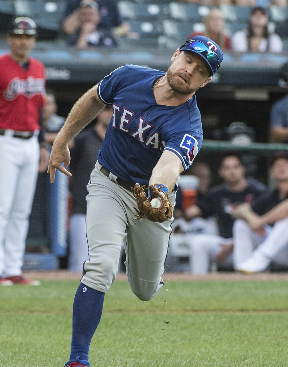Texas Rangers' Logan Forsythe catches a pop fly by Cleveland Indians' Tyler Naquin during the seventh inning of the second game of a baseball doubleheader in Cleveland, Wednesday, Aug. 7, 2019. (AP Photo/Phil Long)