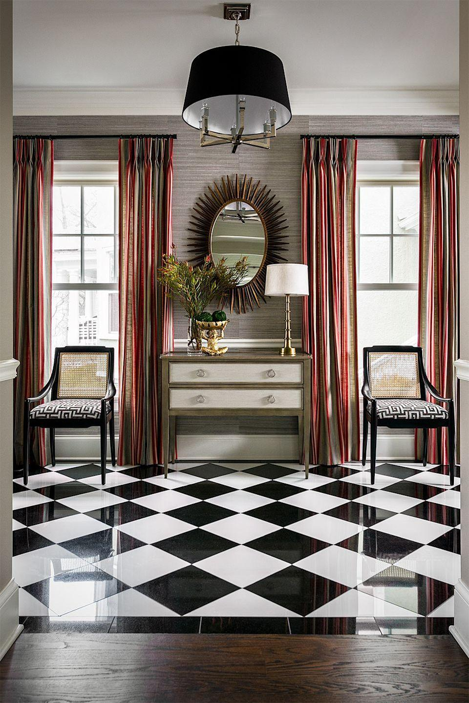 <p>Immaculate black-and-white checkerboard floors and metallic accents are tied together harmoniously with Mark Lavender's use of Phillip Jeffries Bermuda Hemp #5261 Graphite on the walls.</p>