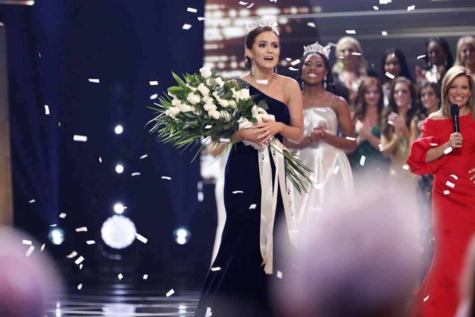 <p>The one-shoulder dress is a style that will last forever. Miss America Camille Schrier sported a dark navy gown as she won the 2020 competition.</p>