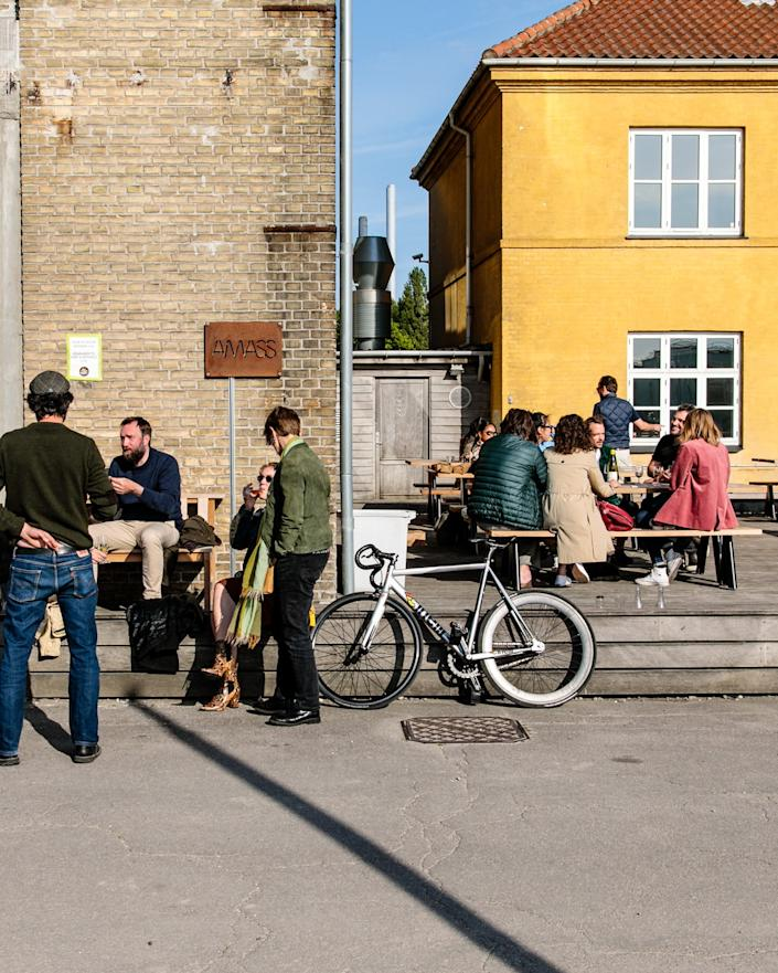 """<div class=""""caption""""> Amass in Copenhagen, an avant-garde restaurant with a focus on sustainability, recently decided to devote half its dining space to a more casual option where diners experience fewer touch points and can take their food to go. </div> <cite class=""""credit"""">Photo: Cory Smith / Courtesy of Amass</cite>"""