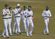Pakistan's Hasan Ali, second right, is congratulated teammates, who took five wickets during the third day of the second cricket test match between Pakistan and South Africa at the Pindi Stadium in Rawalpindi, Pakistan, Saturday, Feb. 6, 2021. (AP Photo/Anjum Naveed)