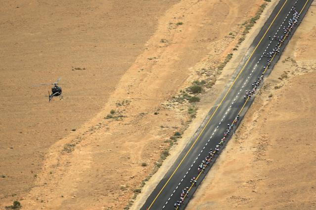Cycling - the 101st Giro d'Italia cycling race - The 229-km Stage 3 from Beersheba to Eilat, Israel - May 6, 2018 - A helicopter flies as riders compete on a main road near Mitzpe Ramon. REUTERS/Amir Cohen