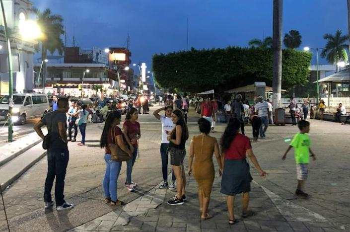 """Migrants mingle in the Miguel Hidalgo park in Tapachula, Mexico, many wondering if their """"American dream"""" may need to be modified (AFP Photo/ALFREDO ESTRELLA)"""