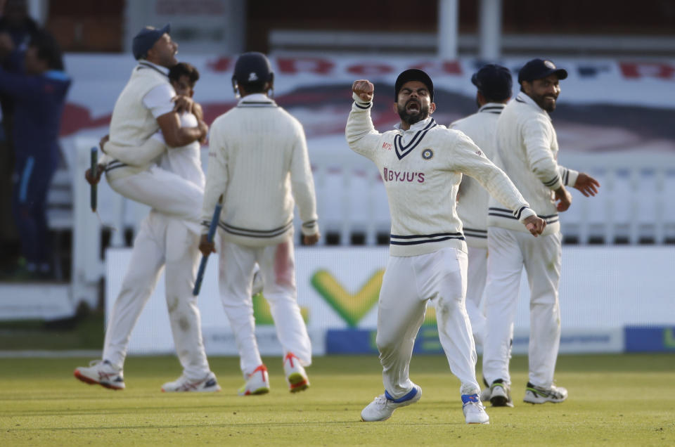 <p>Cricket - Second Test - England v India - Lord's Cricket Ground, London, Britain - August 16, 2021 India's Virat Kohli celebrates winning the second test with teammates after Mohammed Siraj took the wicket of England's James Anderson Action Images via Reuters/Paul Childs</p>